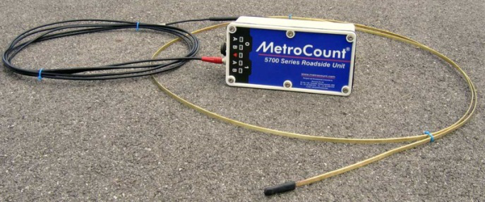 MetroCount MC5720 Advanced Bicycle Counter shown with a typical piezoeelectric axle sensor
