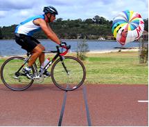 Man riding bicycle over piezo' sensors.