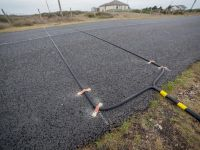 Road tube installation for counting traffic   MetroCount